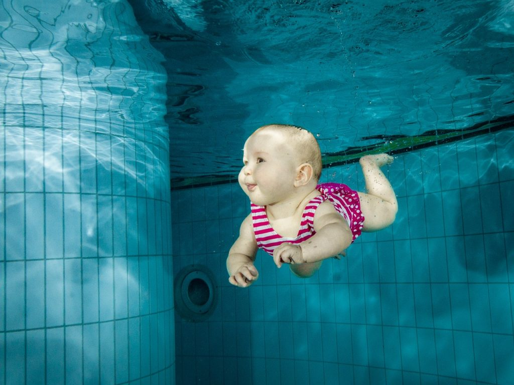 image of baby floating underwater