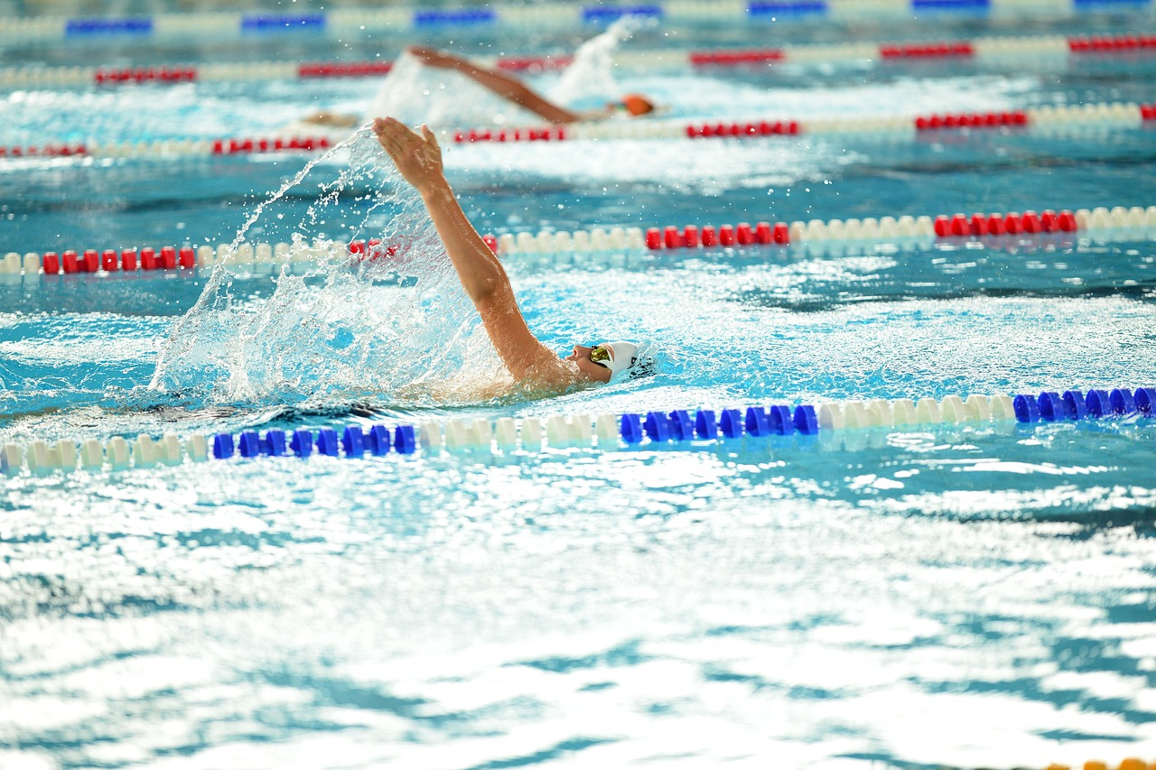 image of a high school backstrok swimmer