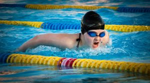Image of high school swimmer swimming butterfly