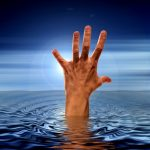 image of hand above water